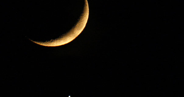 This photo taken on December 1, 2008 in Nice, southern France shows the moon's shadow falling on the Venus planet. The lunar cover-up is similar to a solar eclipse except that it is Venus being hidden instead of the Sun.   AFP PHOTO VALERY HACHE